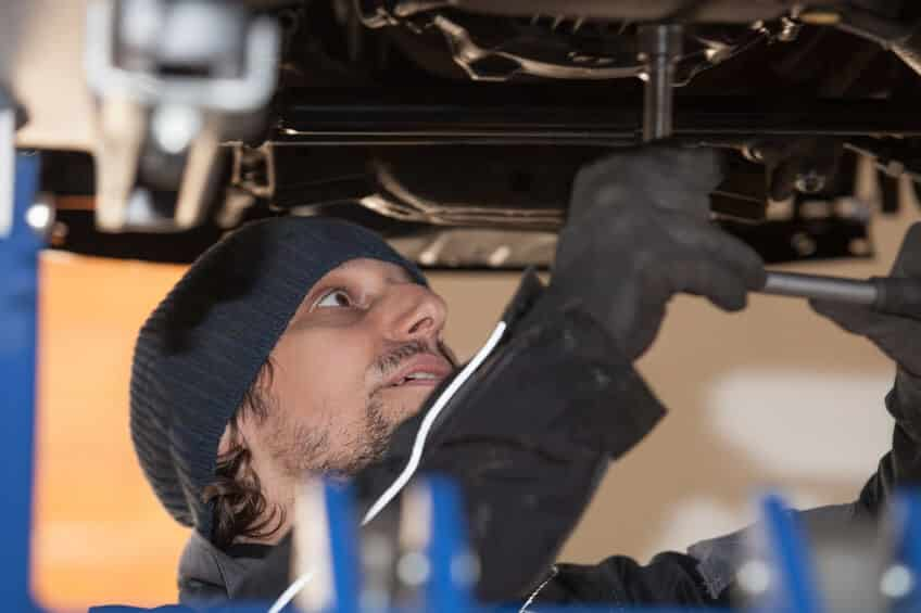 Photo of an auto mechanic tightening the Inner Tie Rods on a Steering Rack and Pinion Gear