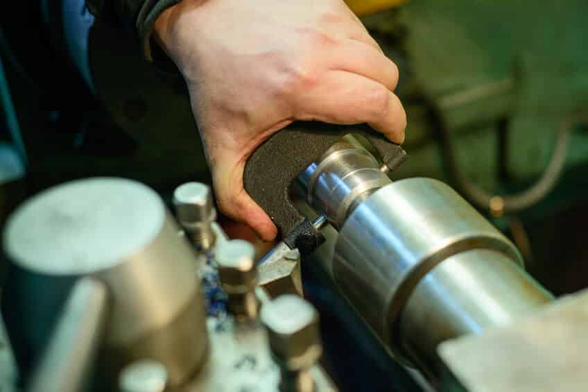 Image of a technician polishing a Steering Rack Core